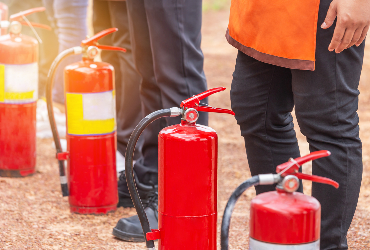 Row of fire extinguisher during training basic fire fighting